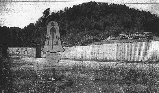 Sign marking the perimeter, note depiction of bound human figure
